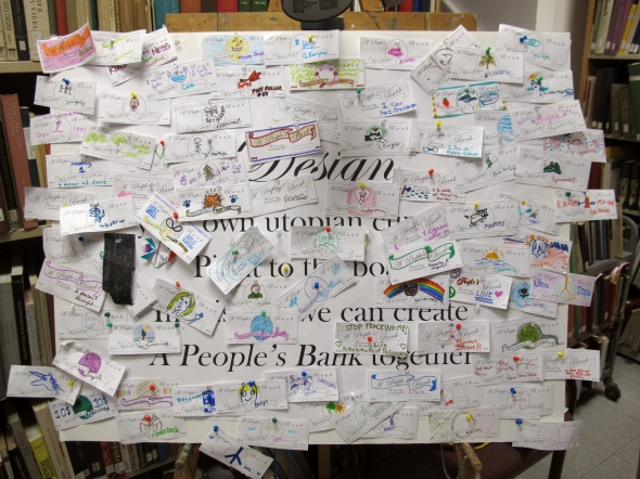 A People's Bank, 2013 installation view. Visitors were encouraged to design their own utopian currencies and post them. ReImaginingMoney.net