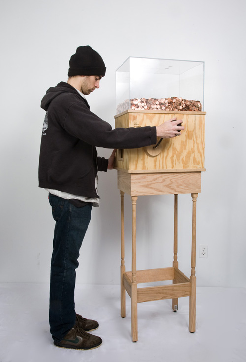 "Blake Fall-Conroy, Minimum Wage Machine (Work in Progress), 2008-9 - ""The minimum wage machine allows anybody to work for minimum wage. Turning the crank will yield one penny every 4.5 seconds, for $8.00 an hour, or NY state minimum wage (2014). If the participant stops turning the crank, they stop receiving money. The machine's mechanism and electronics are powered by the hand crank, and pennies are stored in a plexiglas box. The MWM can be reprogrammed as minimum wage changes, or for different wages in different locations."""