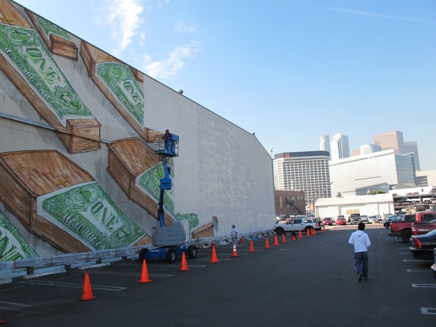 Figure 3 - Workers whitewash a mural by the Italian street artist Blu at the Museum of Contemporary Art in Los Angelis, December 9, 2010. Photograph © Casey Caplow. Courtesy of good.is (http://www.good.is/)