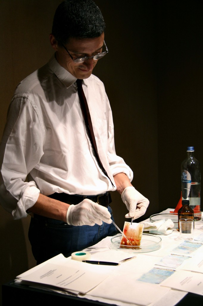 Figure 7 - Cesare Pietroiusti. Image from an untitled 2007 performance in Bruxelle, in which the artist treated money with sulfuric acid. Photo by Martina Della Valle. Courtesy of the artist.