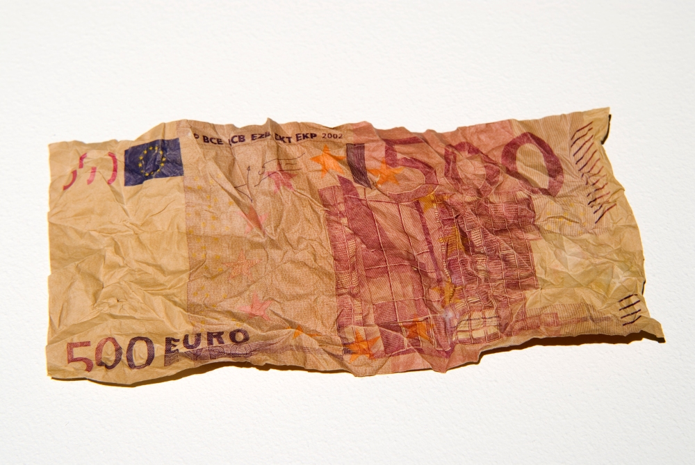 Figure 9a - Cesare Pietroiusti and Paul Griffiths, Eating Money – An Auction, 2005-2007. Performance at the Ikon Gallery, Birmingham UK. Detail of one banknote after passage through the artist's body. Photo by Caters News. Courtesy of the Ikon Gallery.